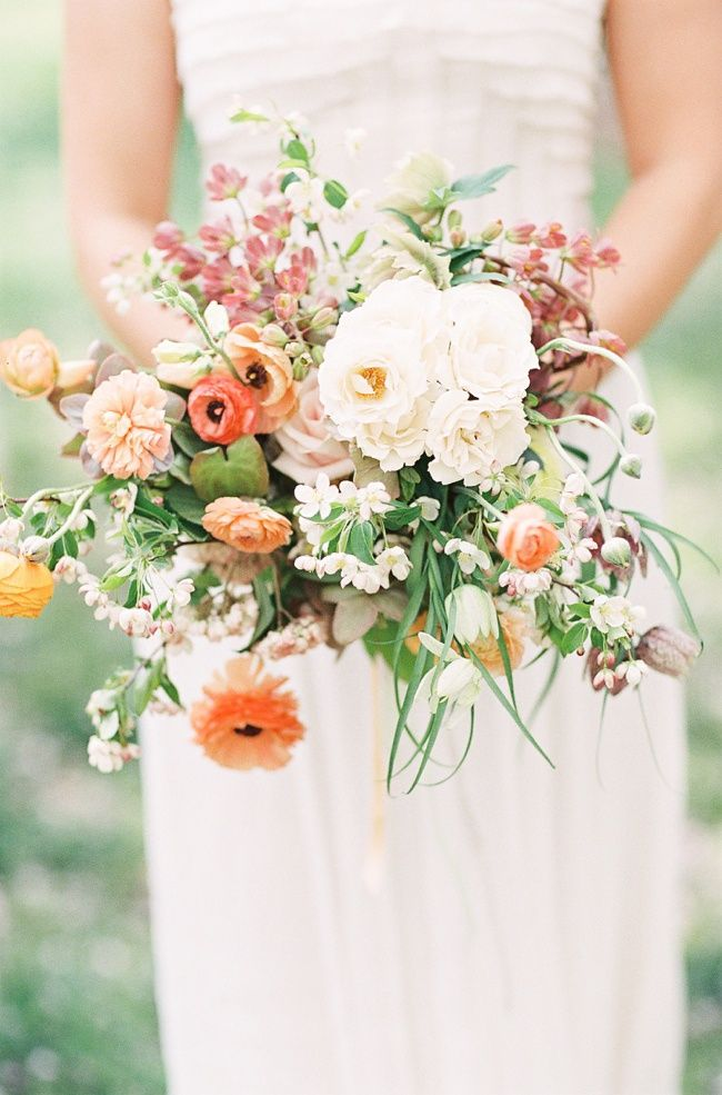 I like how open and natural this bouquet is -- it could be made with the burgundy roses instead of orange ones
