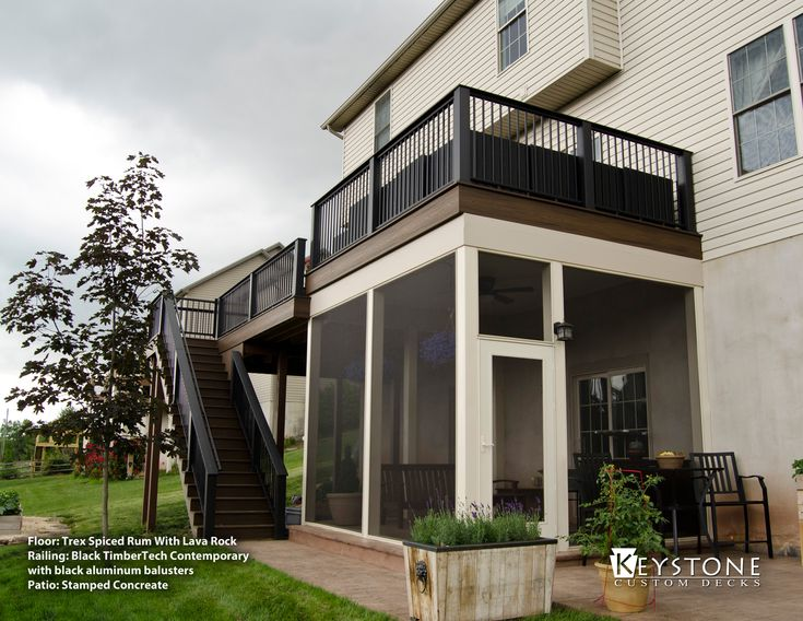 Built Using Spiced Rum Railing With Black Handrails And Balusters. This  Space Also Showcases A