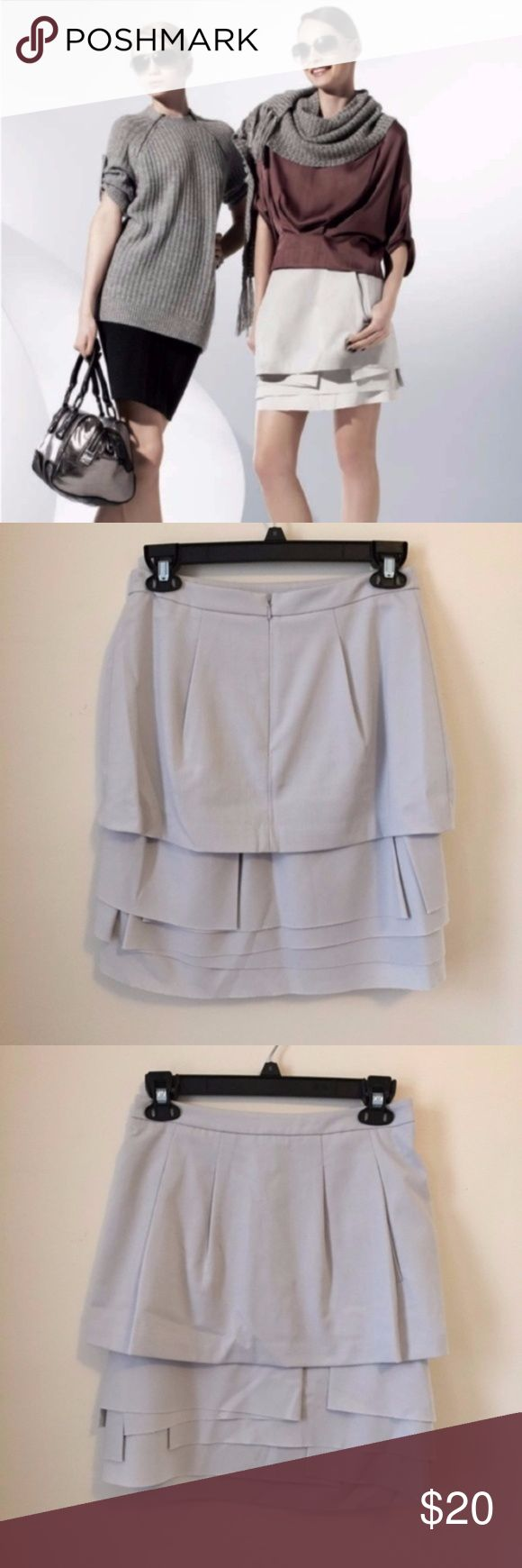 [SALE] BCBCMaxAzria Asymmetrical Tiered Skirt 2 Fantastic skirt from BCBGMaxAzria in a soft light grey color with asymmetrical layers and front pockets. Concealed zip in back. Sturdy construction.  Excellent condition. Size 2. BCBGMaxAzria Skirts Mini
