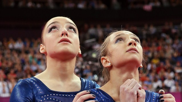 Russia's Aliya Mustafina and Victoria Komova wait for the final scores. #Olympics Olympics.