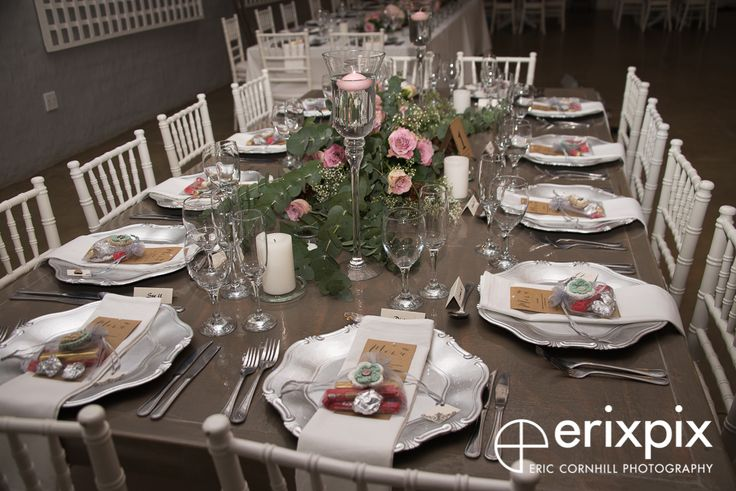 A swag of eucalyptus coupled with beautiful dusty pink 'faith' roses and gypsophila made this guest table a winner