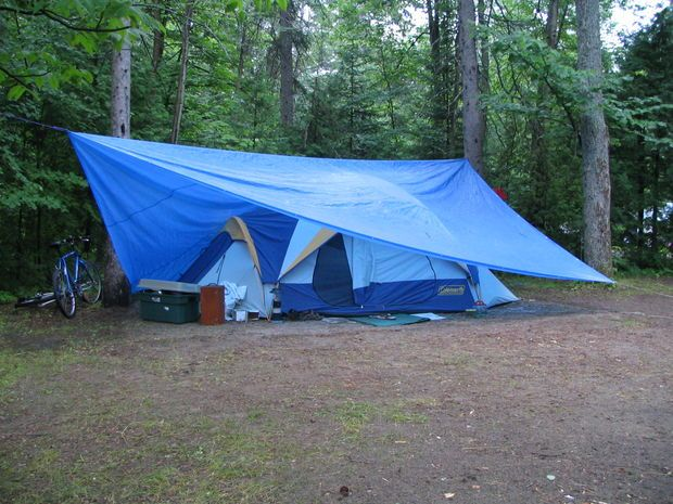This is similar to what we did at the Camporee, except I had to drape it over the tent & stake the tarp out because we didn't have the extra two trees. It still worked well & we were dry. We had a nice vestibule at the door.
