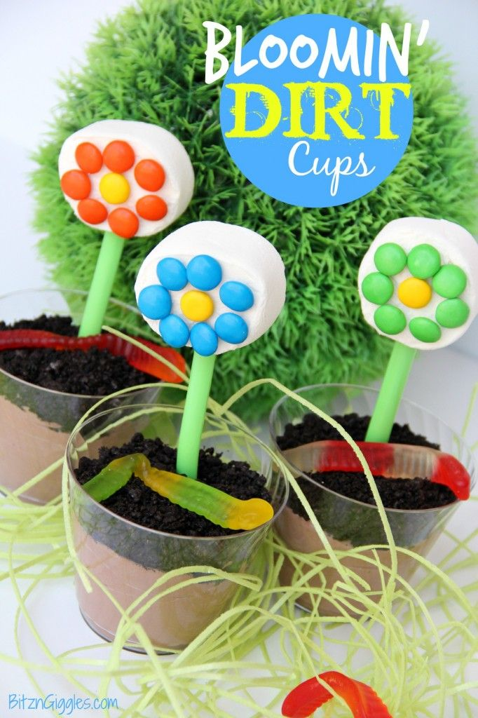 Bloomin' Dirt Cups - A fun and delicious dirt cup treat topped with a marshmallow and M&M flower! {BitznGiggles.com}