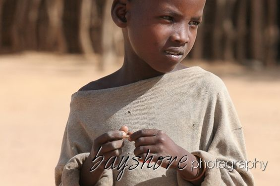 Portrait of a young boy in his village in Tanzania by Bayshore Photography @bayshorephoto