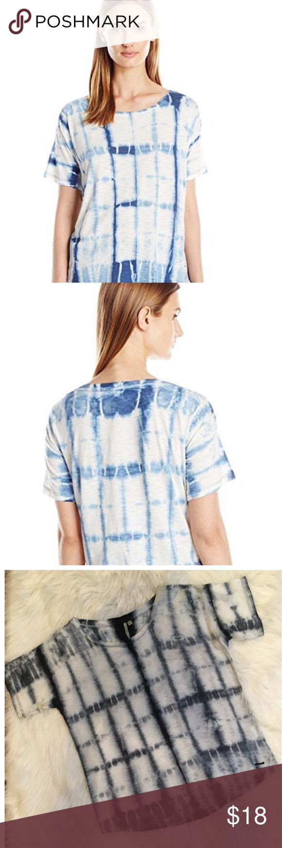 Calvin Klein Jeans Short Sleeve Tie Dye Shirt Calvin Klein Jeans Woman's Short Sleeve Tie Dye Shirt CK Jeans wear tee shirt in tie dyed deep denim blue     on off white background with relaxed fit On trend for summer and perfect with denim Size M 60% cotton/40% modal Very gently used and in perfect condition Calvin Klein Jeans Tops Tees - Short Sleeve