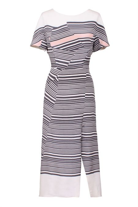 The Transient print silk dress puts a refreshing twist on a classic charcoal stripe. The stripe has been cleverly shattered to create flattering modern lines. The delicate stripe in rose adds a touch of color into an effortless monotone print. This stripe dress features a chic sleeve, semi fitted bodice and gently fluid skirt, embracing the duality of structure and flow. The wrap front skirt with split and slightly dropped back hem gives a pretty softness to the hem while the si…
