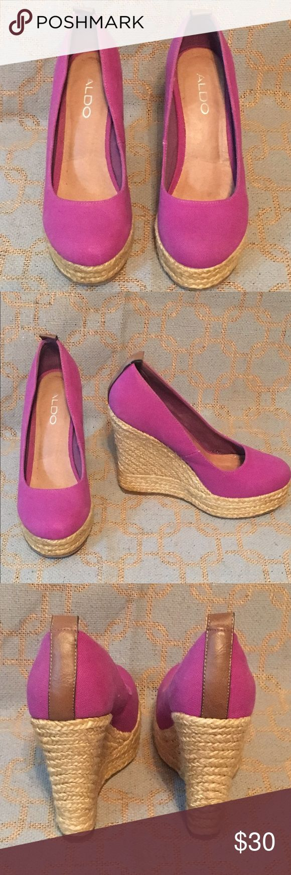 Aldo purple wedge shoes Aldo's brand purple wedge shoes size 7. Wore a few times. Look almost new. Aldo Shoes Wedges
