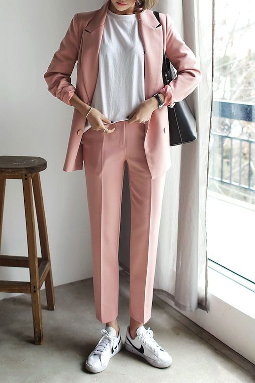 Instantly give your favorite pant suit a sporty-cool update by wearing it with a classic white tee, a simple tote bag and casual white sneakers.