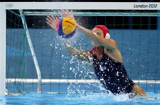 Betsey Armstrong makes a save during the women's water polo quarterfinal match against Italy.
