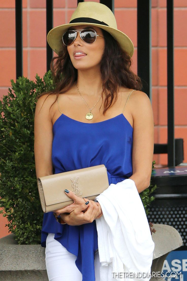 Eva Longoria and her super chill summer look, not to mention her lovely belles du jour YSL clutch.