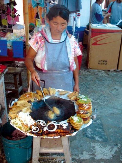 Señora preparando antojitos San Miguel  Allende Mexico. Street food