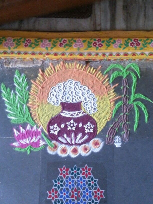 Pongal pot rangoli ....with paddy,sugarcane,lotus,diya.