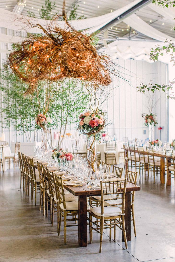 A nest of curly willow branches and intertwined string lights make for a wow-worthy hanging installation. | TheKnot.com