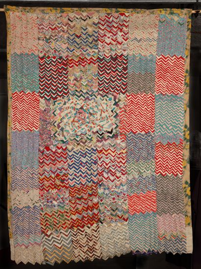 Chevron Quilt, circa 1951, Clementine Hunter. Cotton and wool.  Appears to be made entirely of fabric squares that are folded and layered.