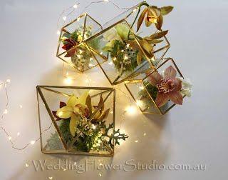 flowers in glasses wedding table flower arrangements