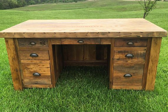This desk is hand crafted from 100-200 year old reclaimed wormy chestnut barnwood. Solid hardwood face frame, top, inlayed sides/back, doors, & dovetail drawers. The drawer pulls & door knobs are aged brass hardware & quality high end soft close drawer slides. This piece comes fully