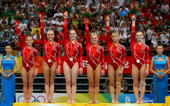 The United States women's gymnastics team wave to the crowd after receiving the silver medal in the artistic gymnastics team event at the National Indoor Stadium during Day 5 of the Beijing 2008 Olympic Games on August 13, 2008 in Beijing, China.