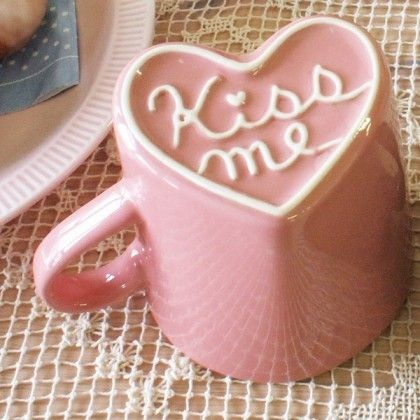 """As you lift your mug to sip your coffee, the bottom of the cup is giving a nice """"Kiss Me"""" hint/reminder. ;-)"""