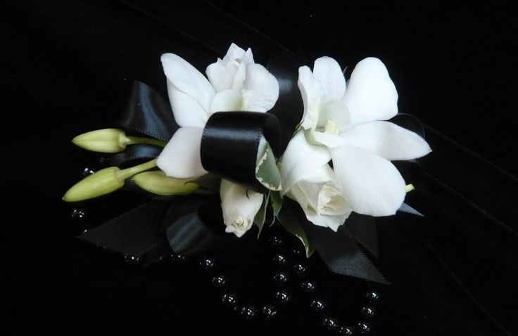 White dendrobium orchids on black ribbon on a black beaded bracelet  wrist #corsage for #prom by Emil J Nagengast Florist in Albany, NY.