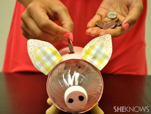 Create a Piggy Bank From a Recycled Water Bottle - I would use pink felt or fabric around the body instead of paper.  Includes pig ear templates.