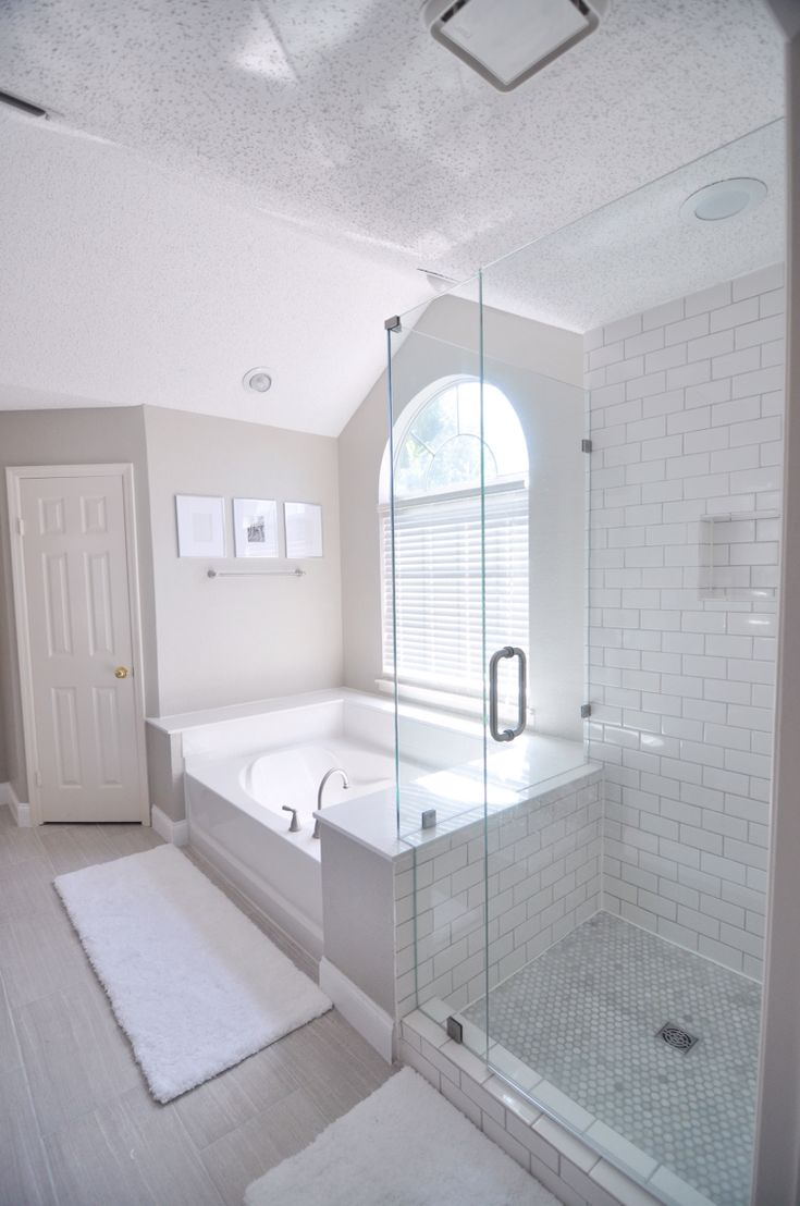 "Master bath Wall color: Benjamin Moore Revere Pewter Tile: Lowe's Leonia Silver (Mapei Warm Gray grout) Shower floor: Home Depot Greecian White 1"" hexagon tiles Shower tile: Home Depot 3x6 subway tile (Mapei warm gray grout)"