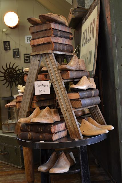 Prim Store Display...old ladder & old wooden shoe forms pair up with old leather bound books.