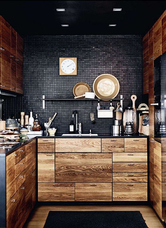 dramatic Kitchen - black tiled wall, woodgrain cabinets