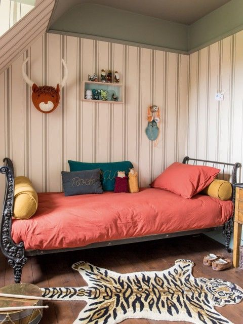 sage green ceiling and vertical stripes   sleigh bed and tiger rug