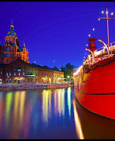 Uspenski Cathedral and the Lightship Relandgrund Uspenski Cathedral - Halkolaituri Vedkajen Marina - Helsinki, Finland. Taken at midnight.
