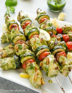 Grilled Lemon Pesto Chicken Kebabs are lemon pesto marinated chunks of chicken skewered with tomatoes and zucchini.  It's a summer meal that's ready in minutes! I'm a pesto addict….how's that for being straightforward?  Sure, I love tomato based sauces too, but when I'm in the mood for a fresh, bright pesto sauce, there's absolutely no substitute. …