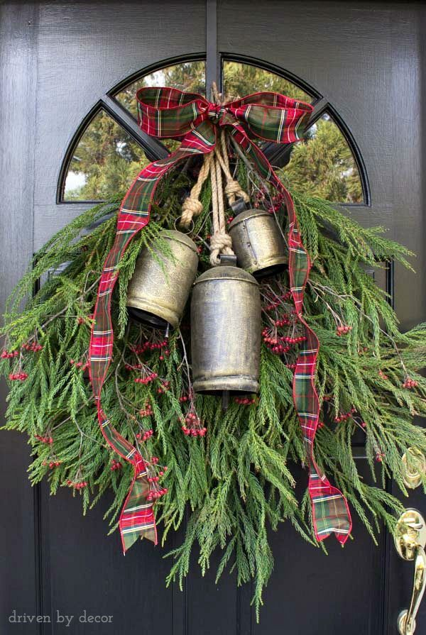A welcoming holiday door decoration made with backyard clippings of greenery and berry branches