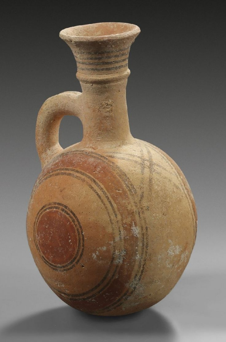 Cypriot jug, 750-600 B.C Ovoid one handled jug without stand, bichrome IV ware with red and black concentric circles, 23.4 cm high. Private collection