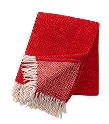 The vibrant red Vega throw from Klippan, Sweden