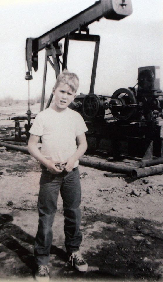 George W. Bush on a field trip with his dad, George H.W. Bush, to the oil fields outside Midland, TX, circa 1955.
