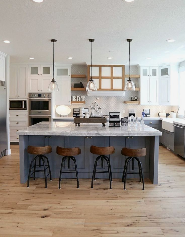 Light Wood Floors With White Cabinets And Blue Island Farmhouse Style Kitchen Farmhouse Kitchen Design