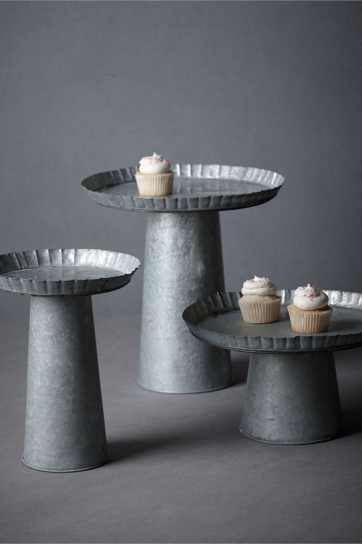 """Galvanized Treat Pedestals  1 / 5  (1)  Write a review    Style: 22834303    Calling to mind old pie plates, these handmade galvanized pedestals add a cool industrial texture to any spread. Iron. Hand wash. Imported.        Short: 7""""H, 12"""" diameter      Tall: 11""""H, 8.5"""" diameter      Extra Tall: 13""""H, 12.5"""" diameter"""