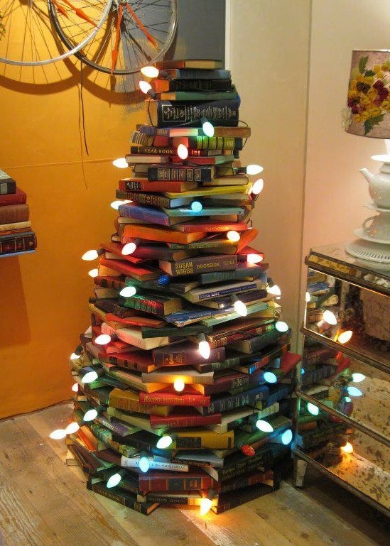 Love this! I love the colorful books, the size and the large colored lights. I need to do this next year and start buying old books at yard sales all summer.