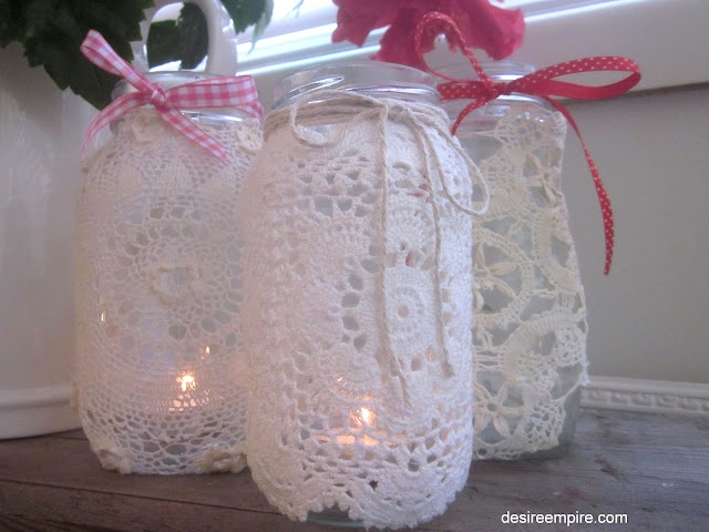 Doily covered candle/jars.... @Elly Smith MAMA LEZ WOULD LOVE THESE AT YOUR WEDDING...hehehe :)