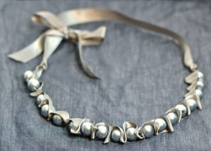 Ladylike Ribbon and Pearl Necklace  http://www.favecrafts.com/Necklaces/Ladylike-Ribbon-and-Pearl-Necklace/ct/1