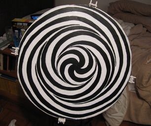 Make A Motorized LSD Spiral - A Powerful Illusion on Your Wall! This says that if you look at it for a bit, then look away, other objects get distorted.  Could be cool to put it at the end of a relatively long hall, so people have to see it, then the next room will be disorienting.