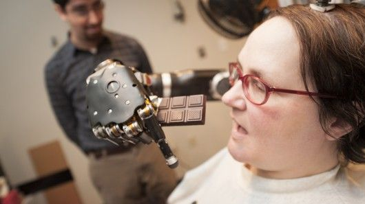 Quadriplegic Jan Scheuermann has been able to feed herself chocolate using a robotic arm directly controlled by her thoughts thanks to researchers from the University of Pittsburgh.