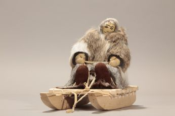 Inukpuk Elisapi Inukjuak  To the church in Kuujjuarapik #14, woman travelling on a sledge to kuujjuuarapik 2003 fur, rabbit; fur, seal ; fur, hare; skin, caribou; skin, cow; wood; fibre 17 x 12,5 x 28 cm  © Avataq Cultural Institute