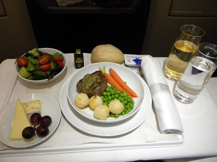 Swiss Airlines - Dinner  Fillet of beef with cafe de paris butter, parisienne potatoes, baby carots and sugar snap peas.