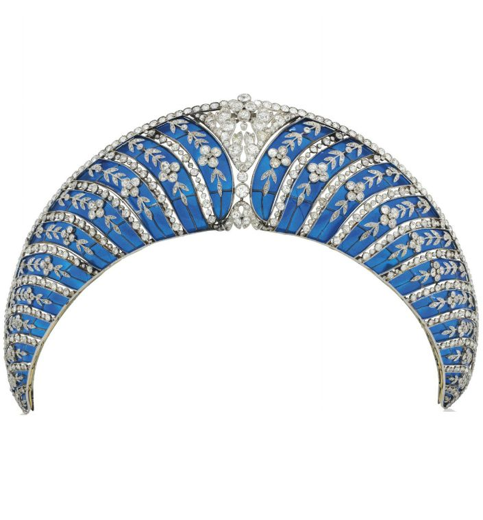 A BELLE ÉPOQUE ENAMEL AND DIAMOND TIARA, BY CHAUMET. Of Kokoshnik design, composed of a series of graduated translucent royal blue plique-à-jour enamel curved panels, each overlaid with old-cut diamond trailing forget-me-not floral motifs, interspersed with collet-set diamond lines, to the cushion-shaped diamond openwork cartouche centre and similarly-set upper border, circa 1910, mounted in platinum and gold.