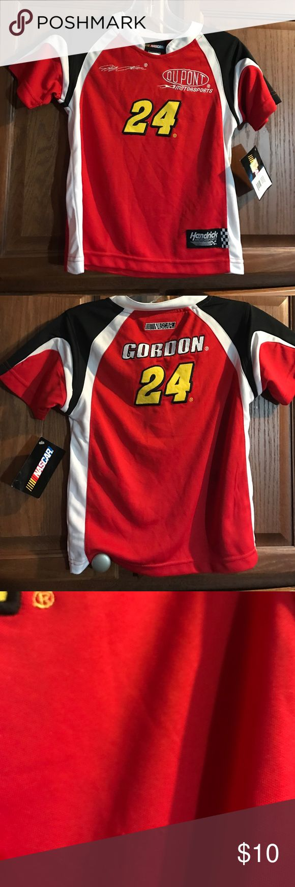 Jeff Gordon Youth Nascar Shirt Size M 5/6 New This is a youth Jeff Gordon jersey shirt!  It is new with tags attached.  Size medium ...  5/6.  There is a couple small picks on the back but you can't really notice them!!!  See picture!! Nascar Shirts & Tops
