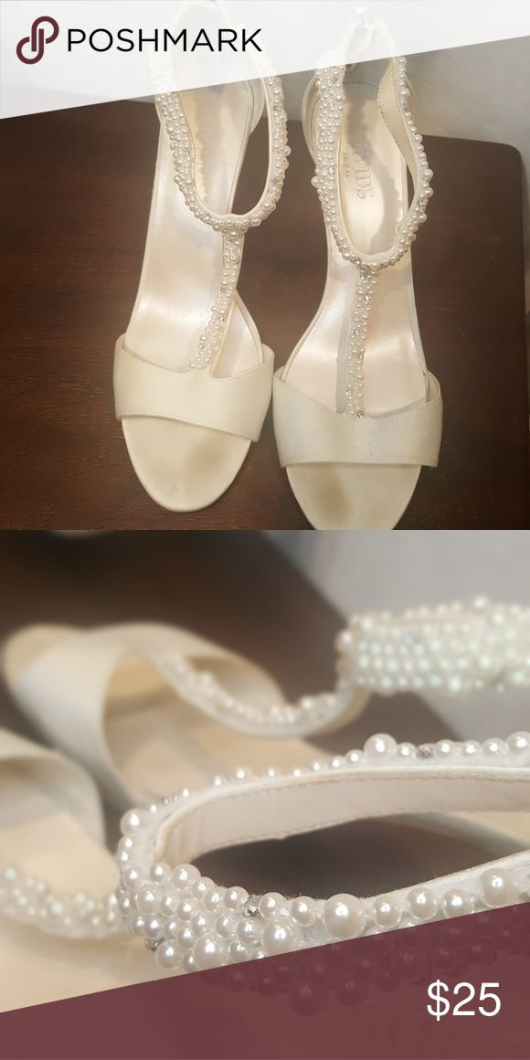 David's bridal ivory heels Beautiful delicate pearl heels. I wore these for my bridal shower and never again. Minimal darkness on the heel and where the toes lay. davids bridal Shoes Heels