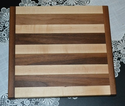 Maple, walnut, and cherry hardwood cutting board