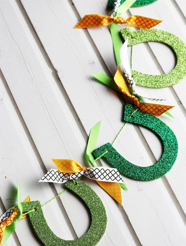 Your St. Paddy's Day party decor isn't complete without glittery green + gold horseshoe garland.