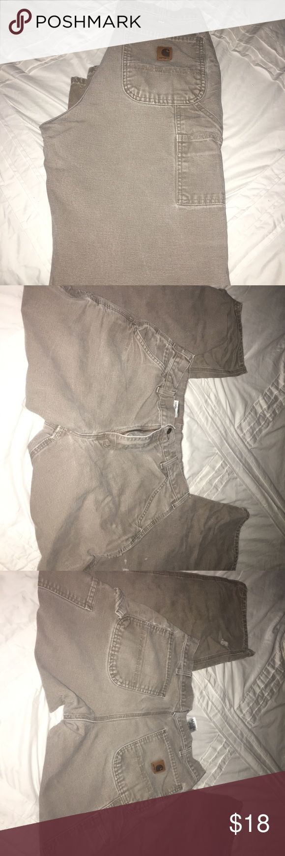 Men's Carhartt Pants Men's Carhartt Pants. Size 33/32. Brown in color. Used condition but still have lots of life left. They have a few small holes I have pictured. Carhartt Pants Cargo