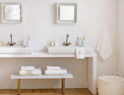 Repeating symmetrical geometrical shapes make for a clean, modern bathroom